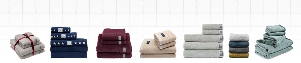 Bunker med forskellige, ensfarvede håndklæder
