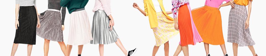 Fine plisserede nederdele i sort, hvid, orange og ternet. Midi, lange og korte.