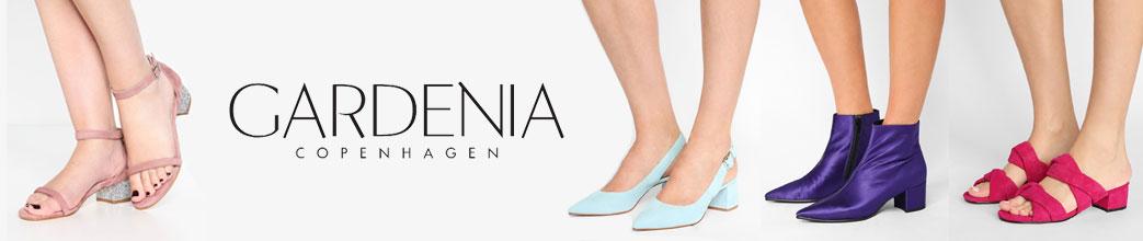 Gardenia sko, støvler og sandaler på kvindefødder
