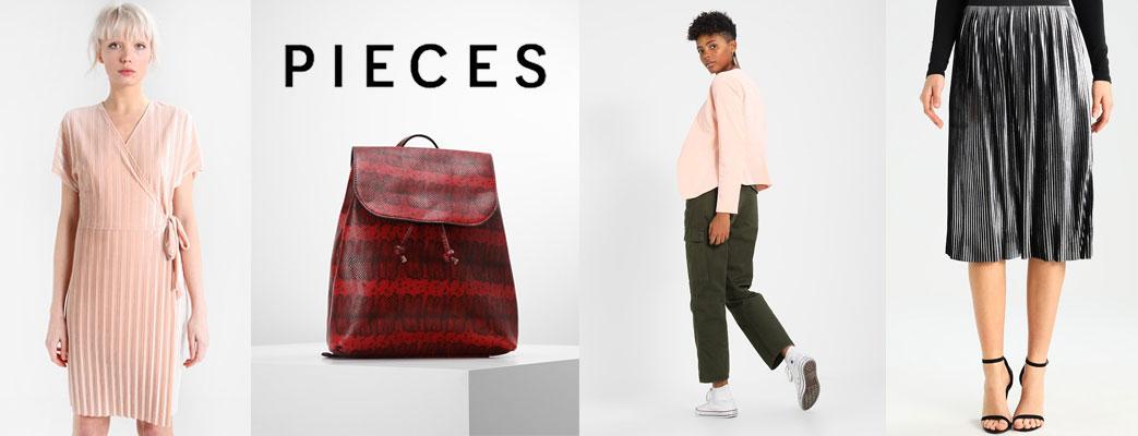 Kvinder i Pieces tøj samt en rød taske